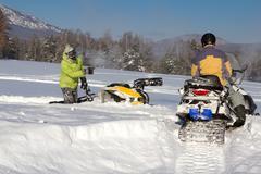 Stock Photo of Two athletes snowmobile