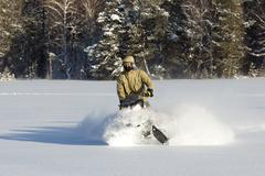 Stock Photo of Athlete on a snowmobile.