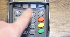 Hand Dials The Pin Code Into Credit Card Reader 4k Stock Footage