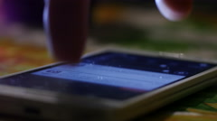 Closeup sliding and typing a smartphone display in internet connection - stock footage