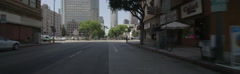 Front view of a Driving Plate: Car travels on 8th Street in Los Angeles, turns Stock Footage