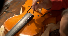 Violin maker Cine 4k measuring - stock footage