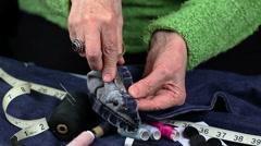 Woman using small scissors Stock Footage