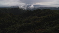 Over a dark forested ridge in Mamalahoa Forest, Oahu. Shot in 2010. Stock Footage