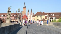 People are walking on the bridge in the center of Wurzburg Stock Footage