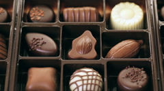 Stock Video Footage of Assorted chocolates on wood table.