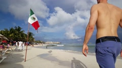 Pretty muscler European man walks at the beach of Playa del Carmen Stock Footage