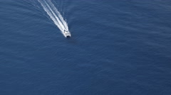 Over a tour boat on blue water in the Hawaiian Islands. Shot in 2010. Stock Footage