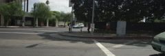 Right Side view of a Driving Plate: Car travels on Cesar E. Chavez Avenue in Los Stock Footage