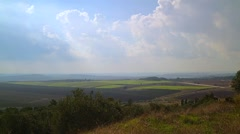 Green field with beautiful summer clouds, Israel Stock Footage