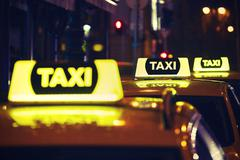 Taxi car on the street at night - stock photo