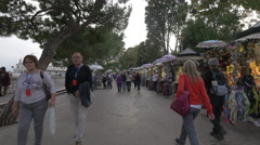Adults and children walking along souvenir stalls in Venice - stock footage