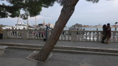 Tourists waiting for a water bus on the waterfront in Venice Stock Footage