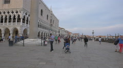 Adults and children walking near Palazzo Ducale in Venice Stock Footage