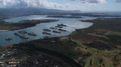 Flying over Pearl Harbor with Diamond Head in distance at right. Shot in 2010. Stock Footage