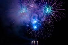 Colorful blue fireworks - stock photo