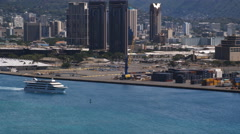 Flying past cruise ship along Honolulu waterfront, Hawaii. Shot in 2010. Stock Footage