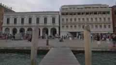 Riva degli Schiavoni and Palazzo Ducale seen from a wooden dock in Venice Stock Footage