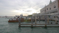 San Clemente Palace boat arriving at the waterfront, Venice Stock Footage