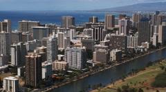 Flying past high-rises along Honolulu's Waikiki Beach. Shot in 2010. Stock Footage