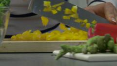 Tracking Right Across Woman Chopping a Yellow Pepper Stock Footage