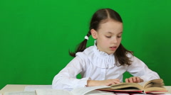 Little girl diligently doing their homework Stock Footage