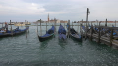 View of people in moored gondolas  on the dock in Venice Stock Footage