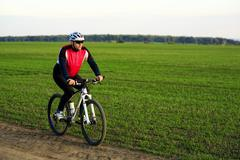 Cyclist on the Meadow Trail - stock photo