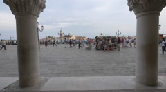 Tourists walking and souvenirs stalls in front of Palazzo Ducale in Venice Stock Footage