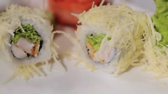 Unfolding sushi rolls on a plate. cheese, shrimp and rice, hand craftsmen work - stock footage