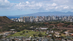 Flying over outskirts of Honolulu, downtown skyline in distance. Shot in 2010. Stock Footage