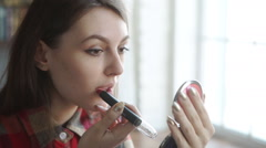 Young woman red lips and lipstick Stock Footage