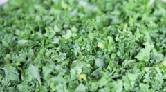 Chopped borecole / kale on turntable. - stock footage