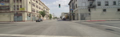 Front view of a Driving Plate: Car travels on 7th Street in Los Angeles from - stock footage