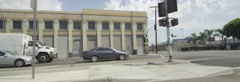 Left Side view of a Driving Plate: Car travels on 8th Street in Los Angeles Stock Footage