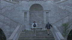 Two men walking on Scala Giganti in Trieste Stock Footage