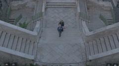 Two women walking on Scala dei Giganti in Trieste Stock Footage