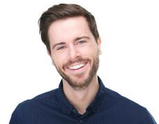 Portrait of a happy young male model smiling Stock Photos