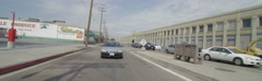 Rear view of a Driving Plate: Car travels on 8th Street in Los Angeles through a Stock Footage