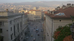 The traffic of Piazza Carlo Goldoni seen from the Giant Stairway of Trieste Stock Footage