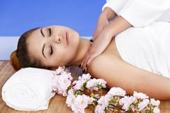 Woman having massage of body in the spa salon. Beauty treatment concept. Stock Photos