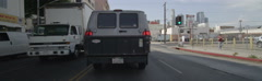 Front view of a Driving Plate: Car travels on 8th Street in Los Angeles from San - stock footage
