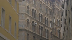 Side view of a building with arched windows in Trieste Stock Footage