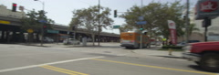 Left Side view of a Driving Plate: Car turns right from 17th Street in Los Stock Footage