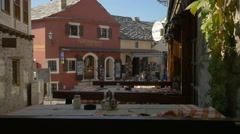 Stock Video Footage of View of Fortuna tours, Restaurant Kulluk and tables in Mostar