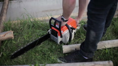 Man turned on chainsaw Stock Footage