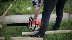 Man prepared a chainsaw to work Stock Footage