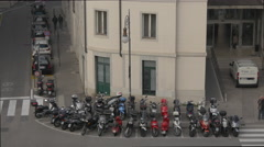 Motorcycles parked near a building in Trieste Stock Footage