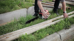 Man sawing a log chainsaw Stock Footage