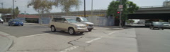 Rear view of a Driving Plate: Car turns right from 17th Street in Los Angeles - stock footage